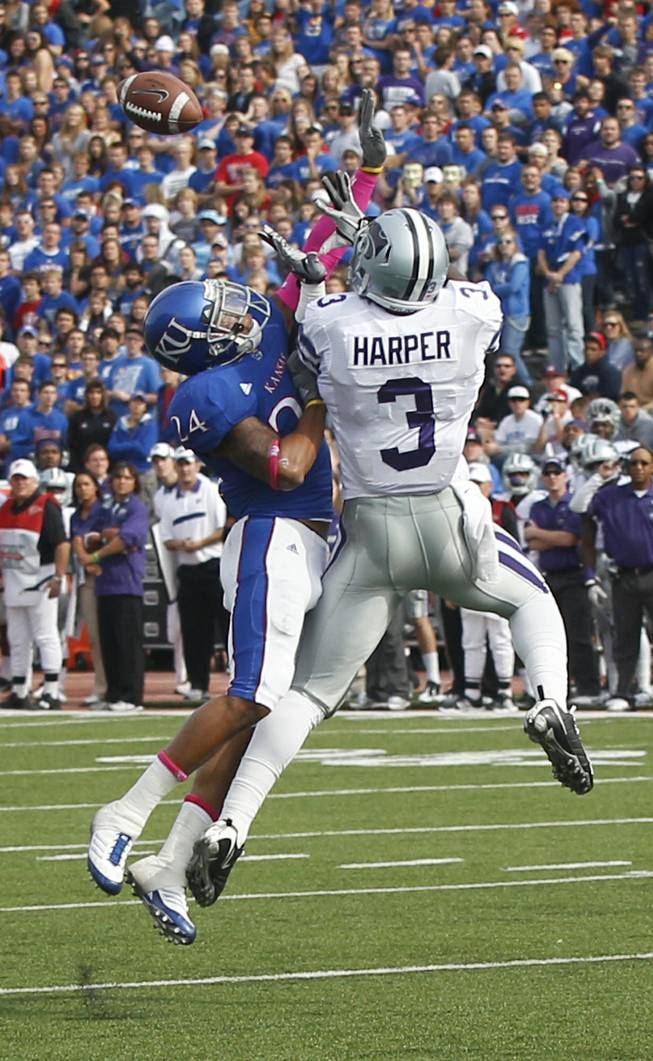 Kansas State wide receiver Chris Harper (3) goes up to catch a pass against Kansas safety Bradley McDougald (24) during the first half of an NCAA college football game in Lawrence, Kan., Saturday, Oct. 22, 2011.