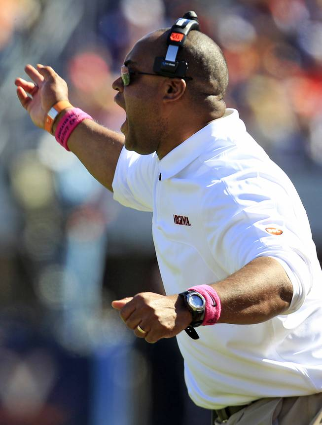 Virginia coach Mike London yells at an official during the first half of an NCAA college football game against Wake Forest at Scott Stadium in Charlottesville, Va., Saturday, Oct. 20, 2012.