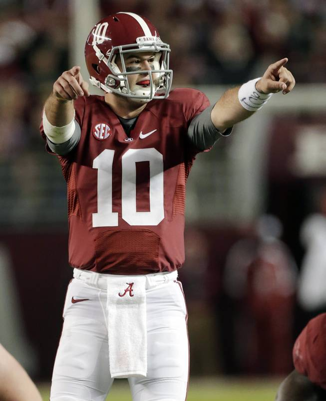 Alabama quarterback AJ McCarron (10) signals a play at the line of scrimmage during the first half of an NCAA college football game against Mississippi State at Bryant-Denny Stadium in Tuscaloosa, Ala.