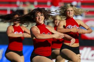 Rebel Girls perform a dance routine during UNLV's game against New Mexico at Sam Boyd Stadium Saturday, Nov. 3, 2012.
