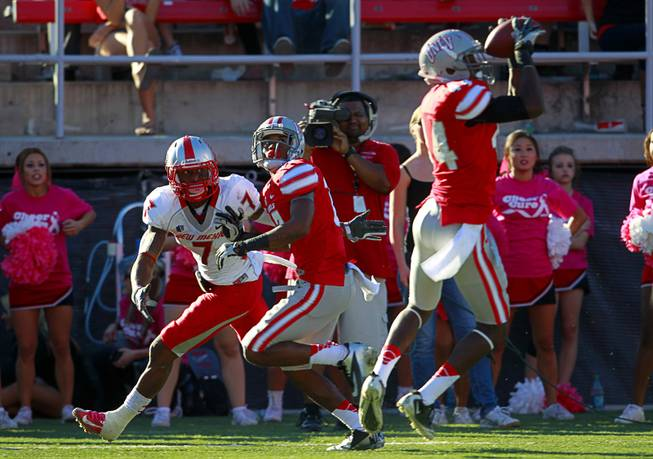 UNLV's Kenny Keys, right, picks off a pass intended for New Mexico's Lamaar Thomas during UNLV's game against New Mexico at Sam Boyd Stadium Saturday, Nov. 3, 2012.