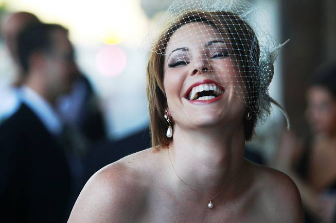 The soon-to-be Rachel Greene laughs during a photo shoot before her wedding.