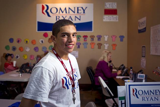 Tommy Bonetti, 16, a volunteer for the Mitt Romney for President campaign, poses in a Henderson field office Monday, Nov. 5, 2012.