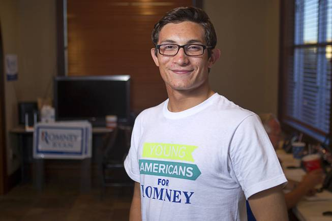 Dorian Achaval, 17, a volunteer for the Mitt Romney for President campaign, poses in a Henderson field office Monday, Nov. 5, 2012.
