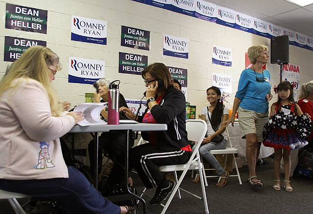 Mitt Romney campaign volunteers make phone calls Monday afternoon from an east Las Vegas campaign office as they await the arrival of Craig Romney and other campaign surrogates.