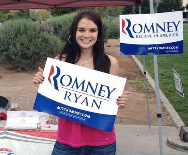 UNLV student Elizabeth Pelkowski, 21, poses with a Mitt Romney campaign sign while registering voters on campus.