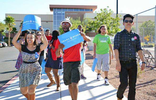Dante Dumas, center, supports the Obama campaign with fellow UNLV students on campus.