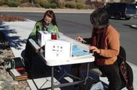Workers tabulate exit polls in Carson City outside the fairgrounds. on Tueday, Nov. 6, 2012.