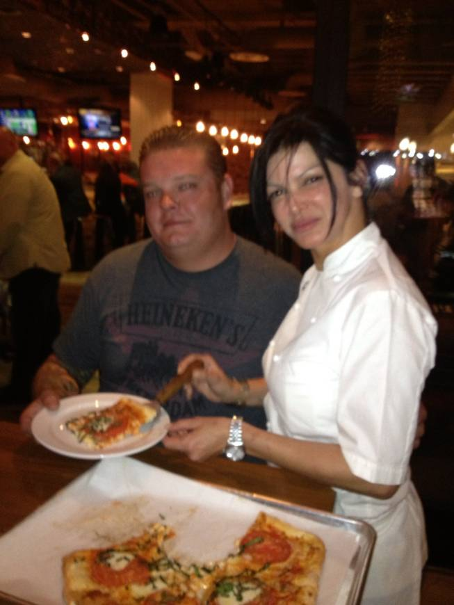 "Corey ""Big Hoss"" Harrison and Carla Pellegrino at the chef's new Meatball Spot in Town Square."