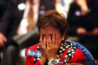 Dorothy Abate of Las Vegas puts her head in the hands after hearing the election called for Barack Obama during a GOP election night watch party at the Venetian in Las Vegas on Tuesday, November 6, 2012.