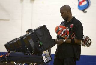 Stanley Hollman, a bartender at the Mandalay Bay, votes on election day at the Fremont Middle School gym Tuesday, November 6, 2012. Without a ride but determined to vote, Hollman set off to the polls on his skateboard. A co-worker in a car spotted him on the way and gave him a ride for part of the journey, he said. STEVE MARCUS