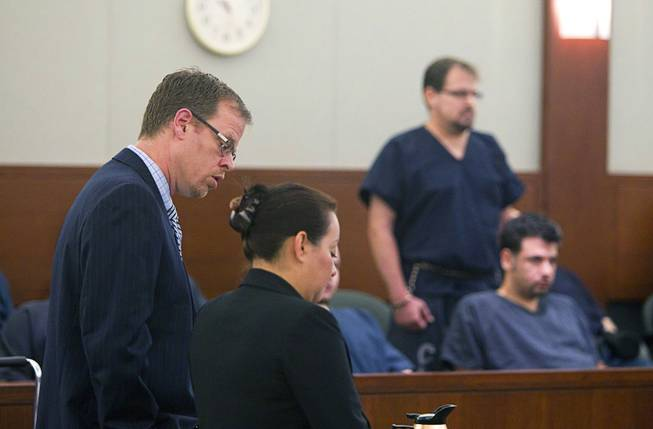 Chief Deputy Attorney General Thom Gover, left and Parole and Probation Officer Adriana Lindquist , address the court as David Schubert, the former Clark County prosecutor who was arrested for buying cocaine and then fled to Mexico, stands in the background at the Regional Justice Center Wednesday, November 7, 2012.