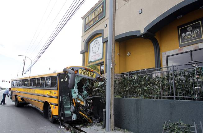 The scene of a school bus crash where only the driver was onboard the bus when it crashed outside of McMullan's Irish Pub on Tropicana Avenue west of the Orleans on Thursday, November 8, 2012.