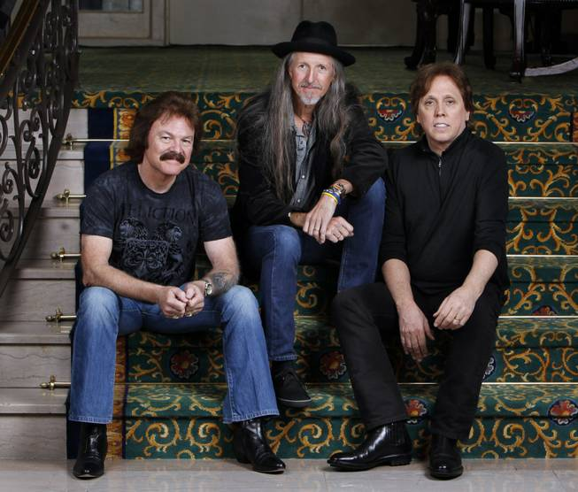 This Sept. 29, 2010 photo shows three members of The Doobie Brothers, from left, Tom Johnston, Pat Simmons, and John McFee, in Nashville, Tenn.
