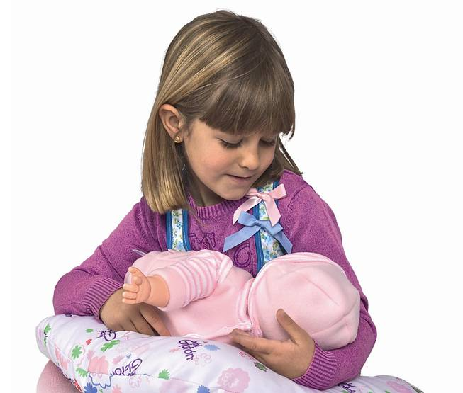 This product image released by Berjuan Toys shows a girl playing with the Breast Milk Baby doll. The breastfeeding doll, whose suckling sounds are prompted by sensors sewn into a halter top, has caught some flak after hitting the U.S. market.