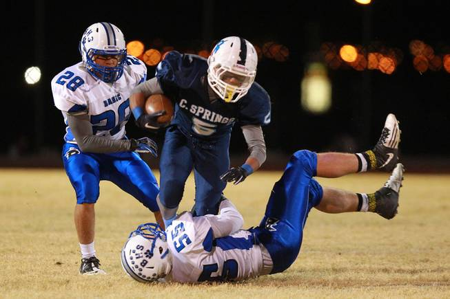 Canyon Springs Donnel Pumphrey is brought down by Basic Zachary Tritsch during their playoff game Friday, Nov. 9, 2012. Canyon Springs won 37-15.