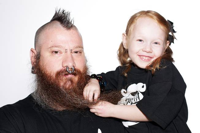 Jeremy Day of Las Vegas will compete in the full beard natural category of the 2012 National Beard and Mustache Championships held in Las Vegas on November 11. Day was photographed on November 9, 2012 in Henderson with his daughter Vivian Day, 4.