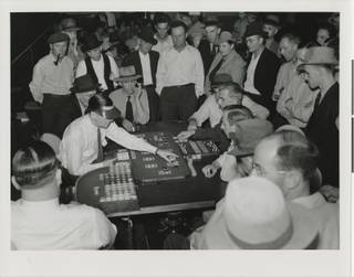 Photograph of men playing faro in a Fremont Street casino, circa 1930.