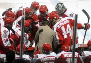 Down by a goal, Wranglers head coach Ryan Mougenel, center, calls his team together to draw up a play during a timeout taken with just over a minute remaining in the third period of play against the Alaska Aces on Friday night.