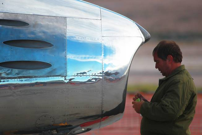 Rob Satterwhite from The Horseman F-86 Flight Team secures an F-86 Sabre after its flight during the annual Aviation Nation air show at Nellis Air Force Base Saturday, Nov. 10, 2012.