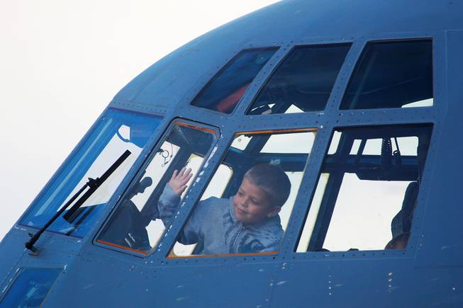 Nicholas Perkins looks out the window on the flight deck of a C-130 during the annual Aviation Nation air show at Nellis Air Force Base Saturday, Nov. 10, 2012.