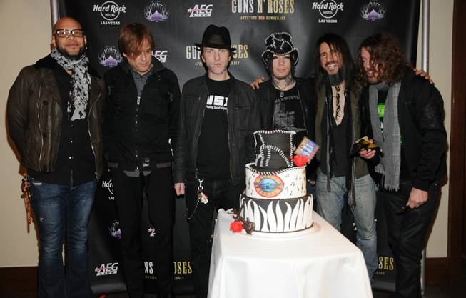 Guns N' Roses guitarist DJ Ashba, third from right in ...