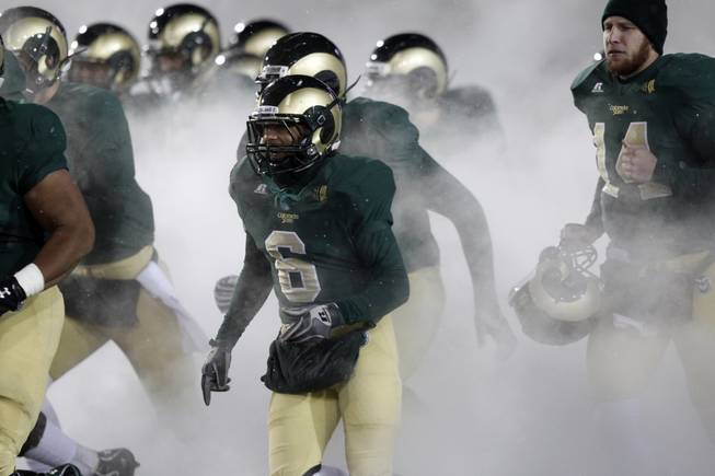 Surrounded by a cloud, Colorado State running back Chris Nwoke (6) joins teammates in taking the field against UNLV in the third quarter of Colorado State's 33-11 victory in an NCAA college football game in Fort Collins, Colo., Saturday, Nov. 10, 2012. (AP Photo/David Zalubowski)