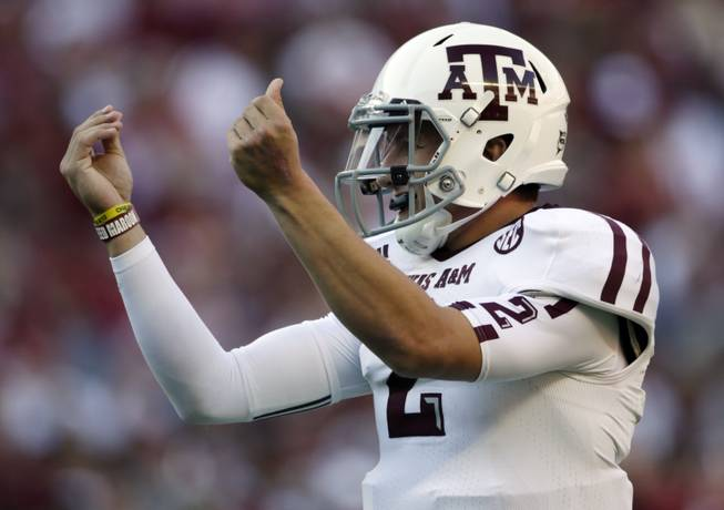 Texas A&M quarterback Johnny Manziel celebrates after the Aggies scored their third touchdown of the first quarter against Alabama at Bryant-Denny Stadium in Tuscaloosa, Ala., on Saturday, Nov. 10, 2012.