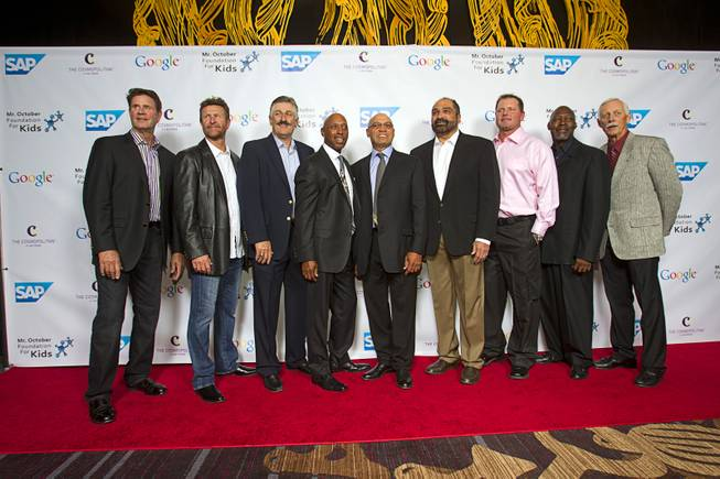 Reggie Jackson, center, poses with guests during his 8th All-Star Celebrity Classic at the Cosmopolitan Sunday, Nov. 11, 2012. From left: Jim Palmer, Robin Yount, Rollie Fingers,  Jeffrey Osborne, Franco Harris, Roger Clemens, Dave Stewart and Joe Rudi. The event raised funds for the Mr. October Foundation for Kids, a charity that supports minority students pursuing education in science and technology.