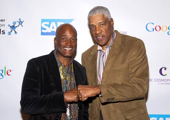 "Playwright Kenny Leon, left, and basketball Hall of Famer Julius ""Dr.J"" Erving arrive for Reggie Jackson's 8th All-Star Celebrity Classic at the Cosmopolitan Sunday, Nov. 11, 2012. The event raised funds for the Mr. October Foundation for Kids, a charity that supports minority students pursuing education in science and technology."