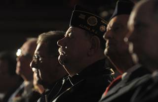 Military veterans listen at a Veterans Day ceremony at Phillipsburg High School in Phillipsburg, N.J., on Sunday, Nov. 11, 2012. At the ceremony, the vets received the high school diplomas that they did not get because they left school to serve in the military.