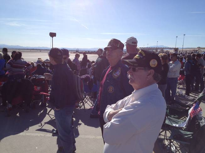 U.S. Army veterans Bill Roe (front) and Louis Rothstein watch the Aviation Nation air show on Veterans Day, Nov. 11, 2012.