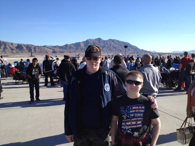 Air Force veteran Mark Goldstrom and his son Trace Goldstrom stand at the Aviation Nation air show at Nellis Air Force Base on Sunday, Nov. 11, 2012.