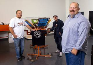 Justin Wallin, left, owner of Booze Brothers Beverage, Christian Escobedo, center, owner of the Half Full Artisan Shop, and Las Vegas Distillery founder George Racz poses in the retail shop next to the distillery in Henderson Monday, Nov. 12, 2012. The distillery, 7330 Eastgate Road, will celebrate the historic bottling of several new spirits -Nevada whiskey, rum, gin and moonshine- on Saturday, Nov. 17. Wallin and Escobedo will celebrate their grand openings.