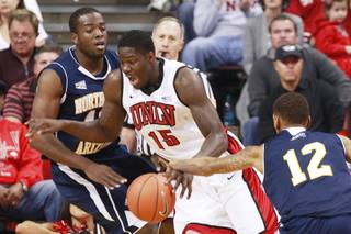 UNLV forward Anthony Bennett is defended by Northern Arizona forward Ephraim Ekanem during the Rebels season opener Monday, Nov. 12, 2012 at the Thomas & Mack. UNLV won 92-54.