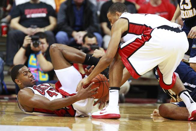 UNLV forward Mike Moser hands a loose ball off to Bryce Dejean Jones during the Rebels season opener against Northern Arizona Monday, Nov. 12, 2012 at the Thomas & Mack. UNLV won 92-54.