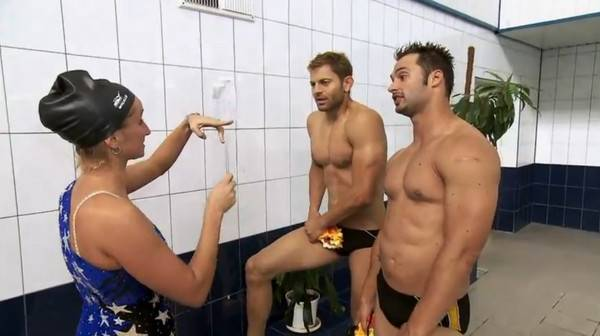 "Jaymes Vaughan and James Davis receive tips about synchronized swimming from a Russian Olympic trainer on CBS' ""The Amazing Race"" on Sunday, Nov. 11, 2012."