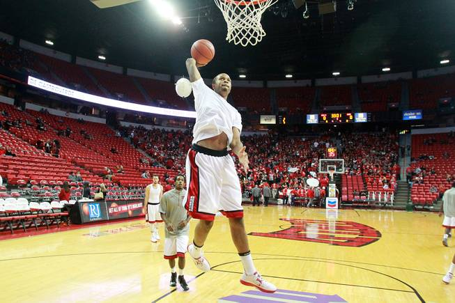 As a near sell out crowd trickles in, Bryce Dejean-Jones warms up with the rest of the Runnin' Rebels before their season opening game against Noprthern Arizona Monday, Nov. 12, 2012 at the Thomas & Mack.