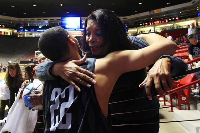 Justin Hawkins' mother, Carmen, hugs to Chace Stanback after practice before UNLV's second round NCAA Tournament game Wednesday, March 14, 2012 at The Pit in Albuquerque. Carmen, who is often at games despite living in Los Angeles, said she considers all of the Rebels players her sons by another mother.