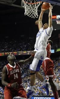 Kentucky's Anthony Davis, center, shoots between Alabama's Moussa Gueye (14) and JaMychal Green during the first half of an NCAA college basketball game in Lexington, Ky., Saturday, Jan. 21, 2012. Kentucky won 77-71.