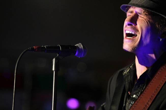 """America's Got Talent"" winner Michael Grimm entertains the crowd during Ethel M Chocolates 19th Annual Holiday Cactus Lighting in Henderson on Tuesday, Nov. 13, 2012."