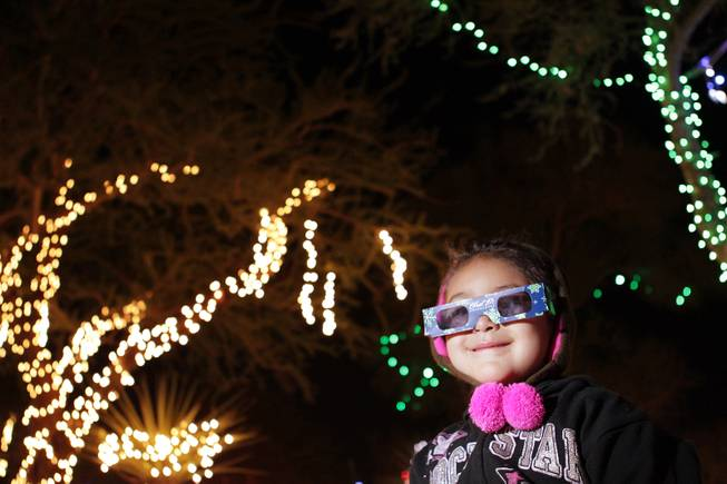 Amara Deanda, 4, of Las Vegas enjoys the 3-D glasses that make the lights look like snowflakes during Ethel M Chocolates 19th Annual Holiday Cactus Lighting in Henderson on Tuesday, November 13, 2012.
