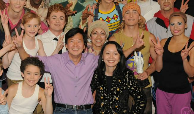 "Ken Jeong, in purple, with cast members of ""Love"" at the Mirage."