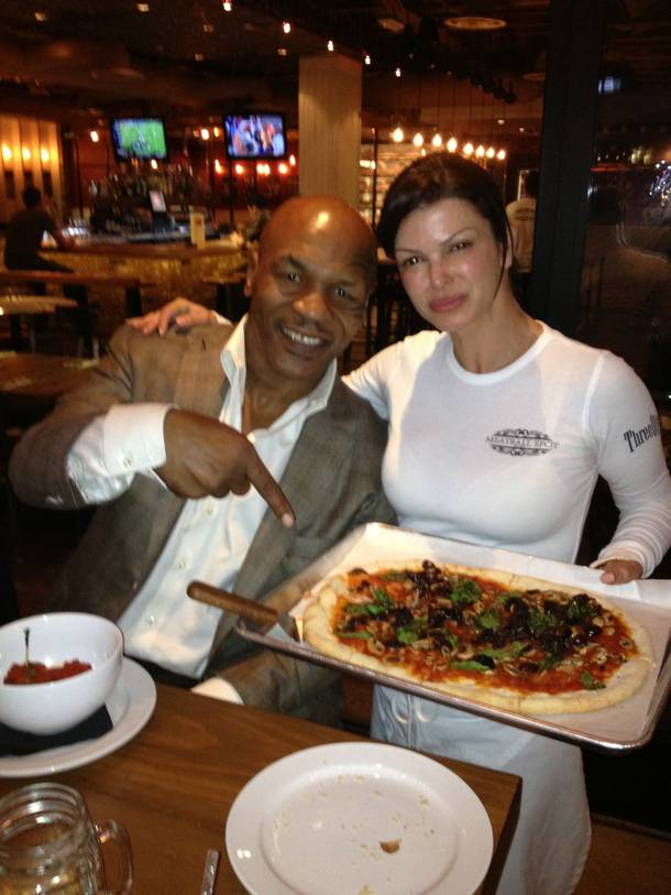 Mike Tyson and Carla Pellegrino at her Meatball Spot in Town Square.