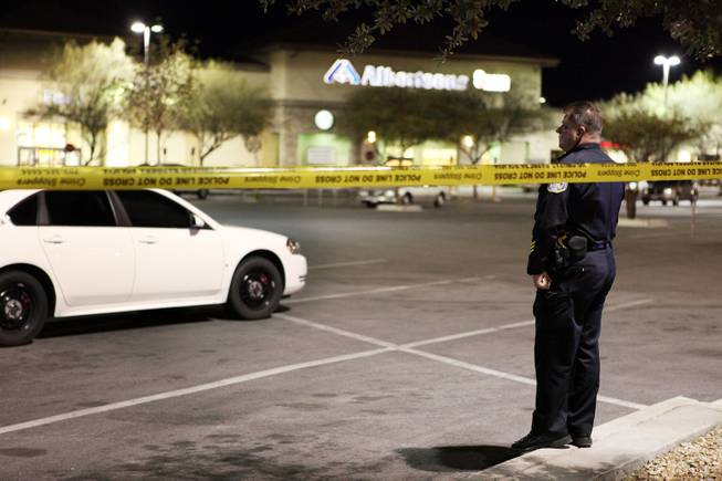 Henderson Police officers guard the scene outside of an Albertsons grocery store where Henderson Police shot a man Wednesday afternoon at the corner of Lake Mead Parkway and Boulder Highway in Henderson on Wednesday, November 14, 2012.