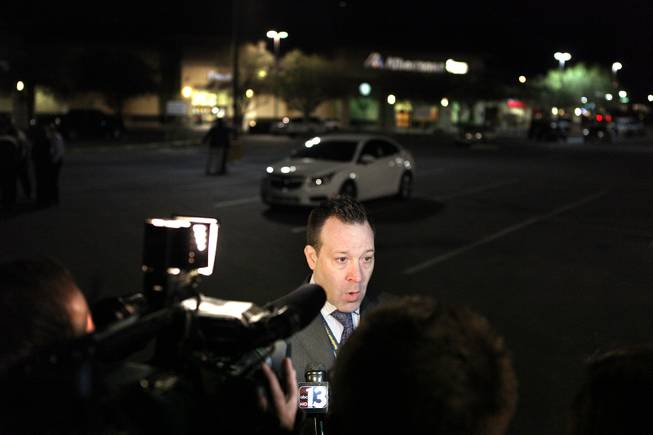 Henderson Police spokesman Keith Paul talks to the media outside of an Albertsons grocery store where Henderson Police shot a man Wednesday afternoon at the corner of Lake Mead Parkway and Boulder Highway in Henderson, Nov. 14, 2012.