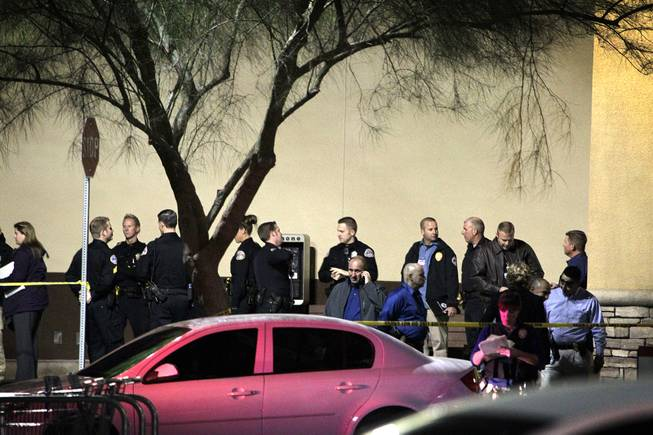 Law enforcement gather outside of an Albertsons grocery store where Henderson Police shot a man Wednesday afternoon at the corner of Lake Mead Parkway and Boulder Highway in Henderson on Wednesday, November 14, 2012.