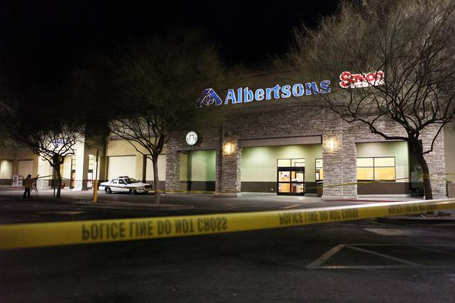 The scene outside of an Albertsons grocery store where Henderson Police shot a man Wednesday afternoon at the corner of Lake Mead Parkway and Boulder Highway in Henderson on Wednesday, November 14, 2012.
