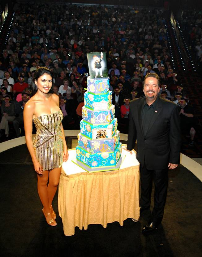 Terry Fator and wife Taylor Makakoa celebrate the headliner's new deal with the Mirage to 2016 on Tuesday, Nov. 13, 2012. Guests received commemorative 2016 Terry Fator glasses and Duggie brownies.