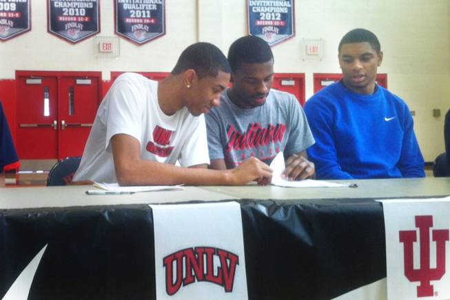 Findlay Prep and UNLV signee Christian Wood, left, reviews letter of intent paper work with teammate Stanford Robinson Wednesday, November, 14, 2012, at the Henderson International School. Wood signed with UNLV; Robinson inked with Indiana. Allerick Freeman (far right) is committed to UCLA and scheduled to sign Friday.